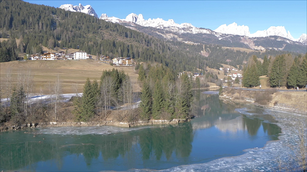 View of Avisio River towards Soraga in winter, Province of Trento, South Tyrol, Italy, Europe