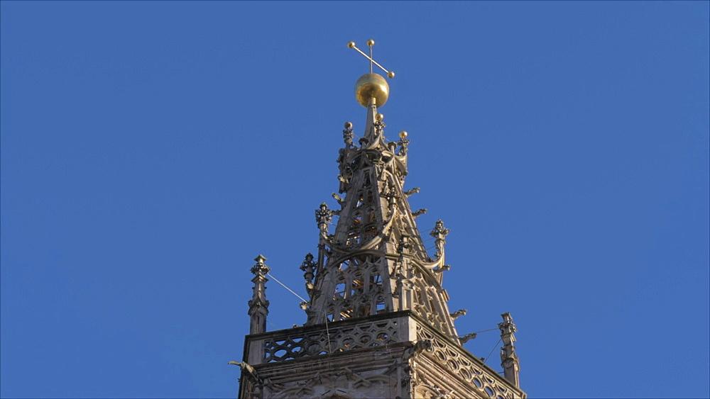 View of ornate clock tower of Maria Himmelfahrtr in winter, Bolzano, Province of Bolzano, South Tyrol, Italy, Europe