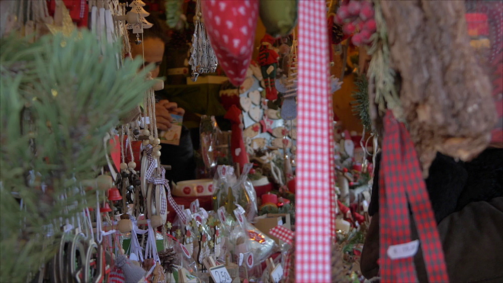 View of Christmas decorations and shopper in Piazza Walther Von der Vogelweide, Bolzano, Province of Bolzano, South Tyrol, Italy, Europe