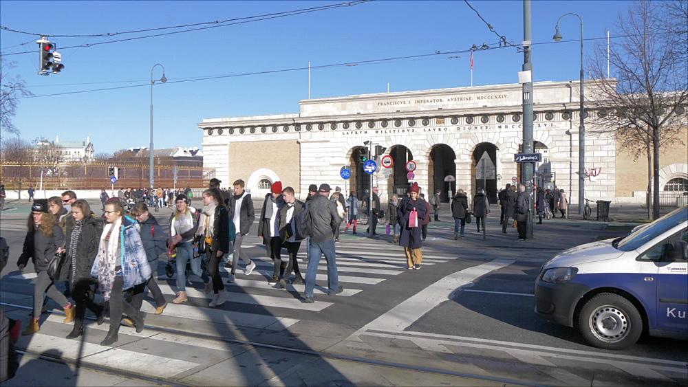 Visitors crossing road and Ausseres Burgtor in Heldenplatz in winter, Vienna, Austria, Europe