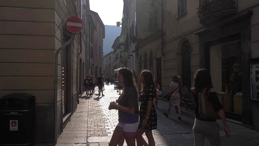 People on busy street near Duomo in Como, Lake Como, Lombardy, Italian Lakes, Italy, Europe