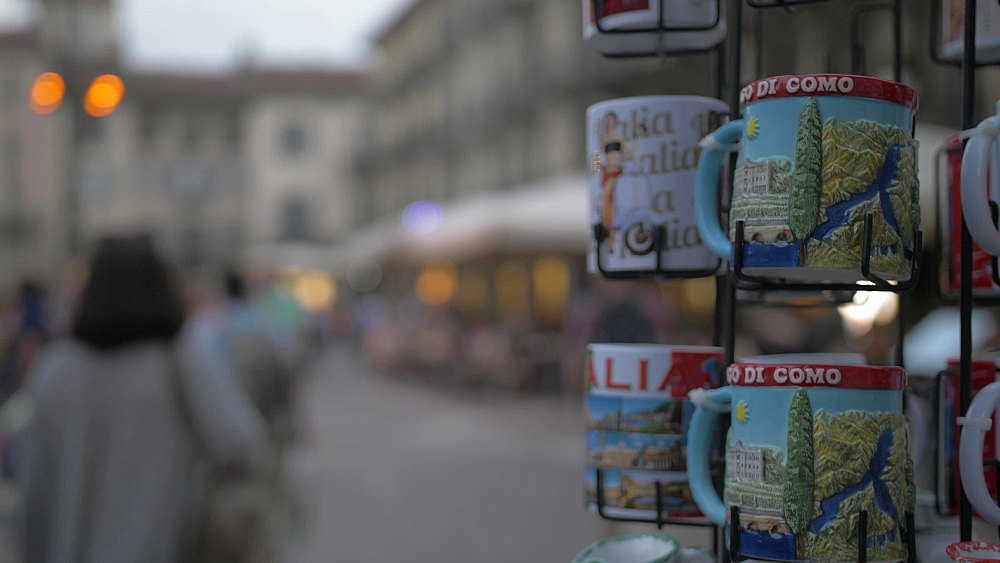 People out of focus in Piazza del Duomo at dusk in Como, Lake Como, Lombardy, Italian Lakes, Italy, Europe