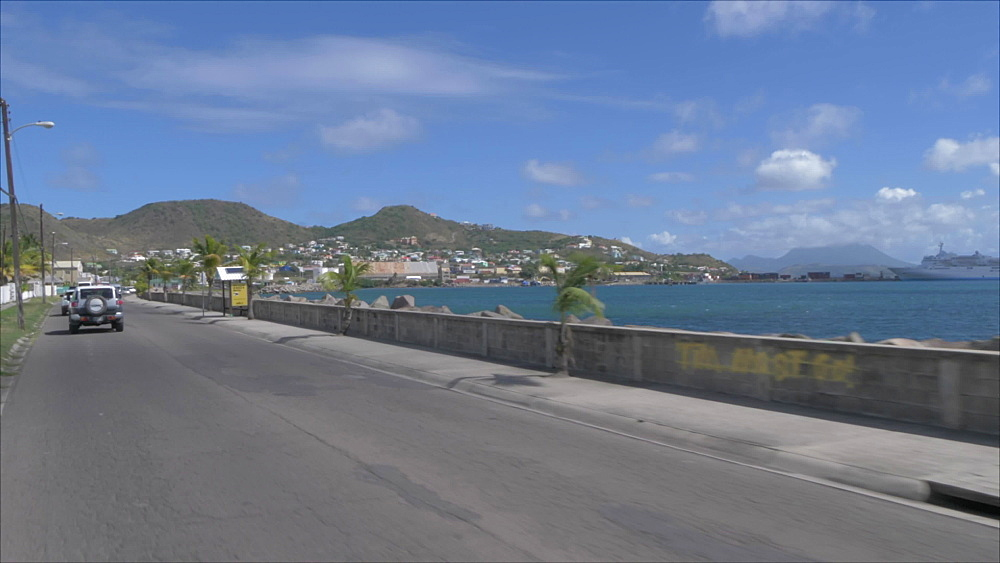 Onboard taxi shot along Bay Road, Basseterre, St. Kitts, St. Kitts and Nevis, Leeward Islands, West Indies, Caribbean, Central America