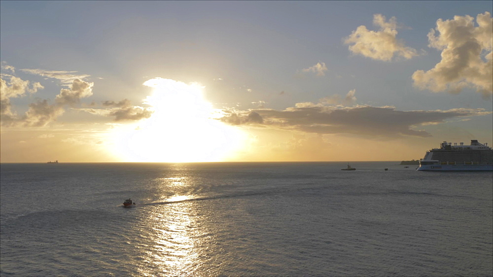 View of setting sun over Caribbean Sea from cruise ship, Basseterre, St. Kitts, St. Kitts and Nevis, Leeward Islands, West Indies, Caribbean, Central America