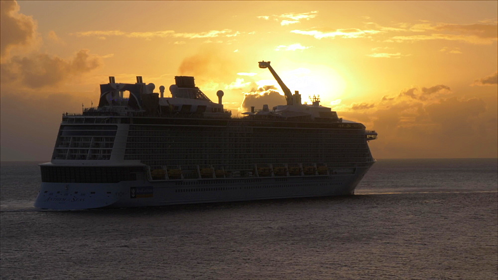 View of cruise ship at sunset, Basseterre, St. Kitts, St. Kitts and Nevis, Leeward Islands, West Indies, Caribbean, Central America
