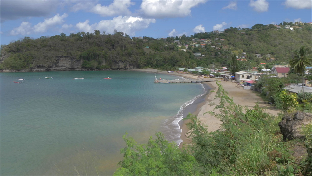 Crane shot of Canaries town and beach viewed from elevated position, St. Lucia, West Indies, Caribbean, Central America