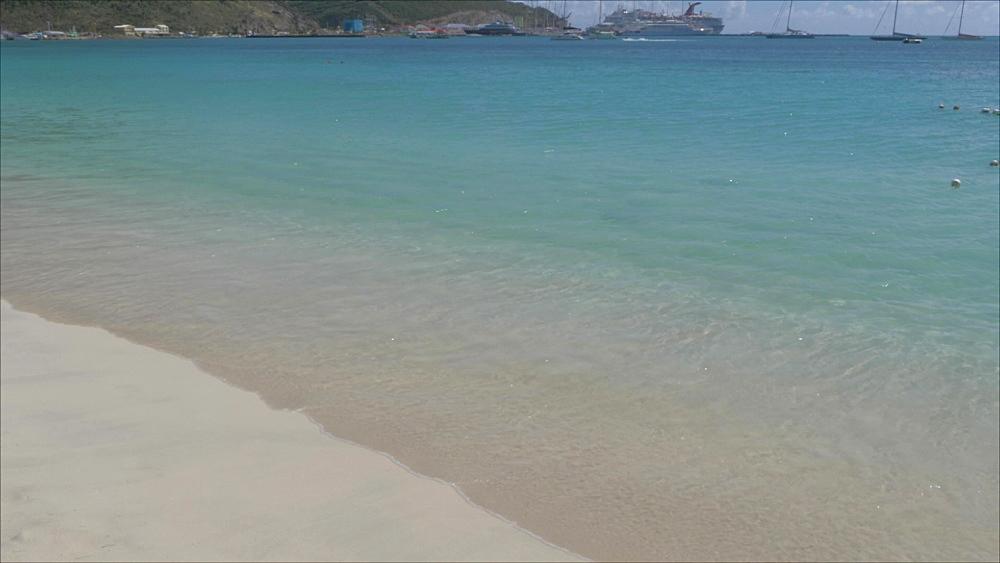Waves lapping on beach in Philipsburg, Philipsburg, St. Maarten, Dutch Antilles, West Indies, Caribbean, Central America