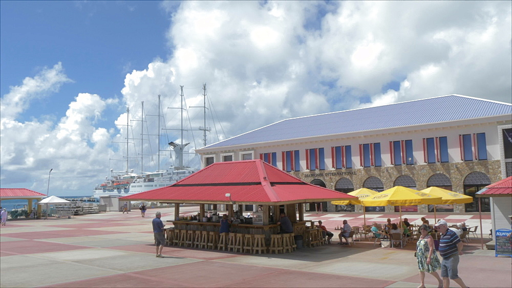 View of statue and duty free area at cruise ship terminal, Philipsburg, St. Maarten, Dutch Antilles, West Indies, Caribbean, Central America