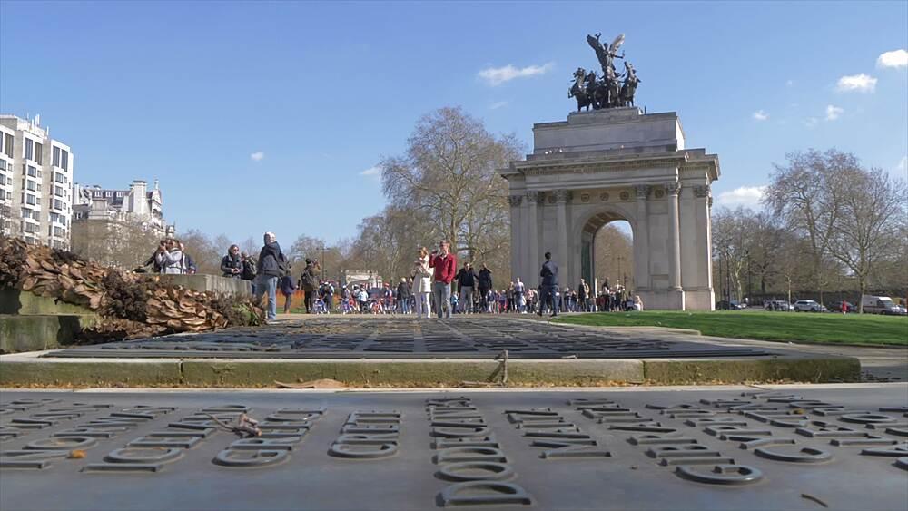 Slider shot of Royal Artillery Memorial and Wellington Arch in springtime, London, England, United Kingdom, Europe