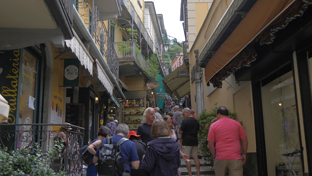 Visitors on cobbled street of lakeside town of Bellagio, Bellagio, Lake Como, Lombardy, Italian Lakes, Italy, Europe
