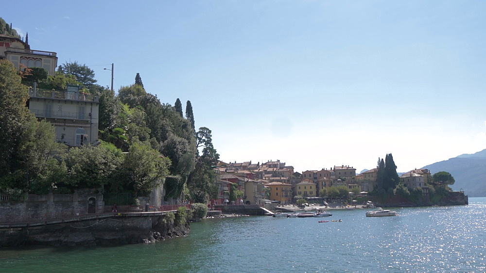 Onboard ferry shot approaching lakeside town of Varenna, Varenna, Lake Como, Lombardy, Italian Lakes, Italy, Europe