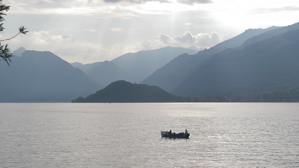 Rowing boat on Lake Como from lakeside town of Bellagio, Bellagio, Lake Como, Lombardy, Italian Lakes, Italy, Europe