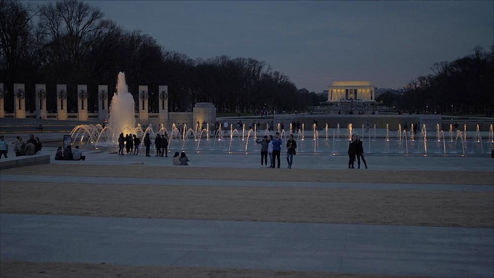 Pan shot of World War ll and Lincoln Memorial at dusk, Washington DC, District of Columbia, USA