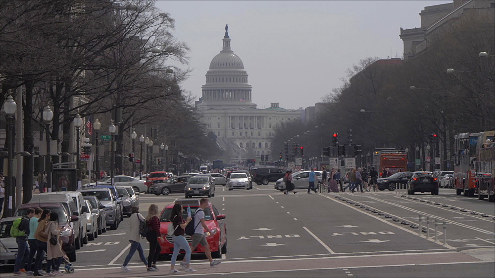 The United States Capitol Building and traffic on Pennsylvania Avenue, Washington DC, United States of America, North America