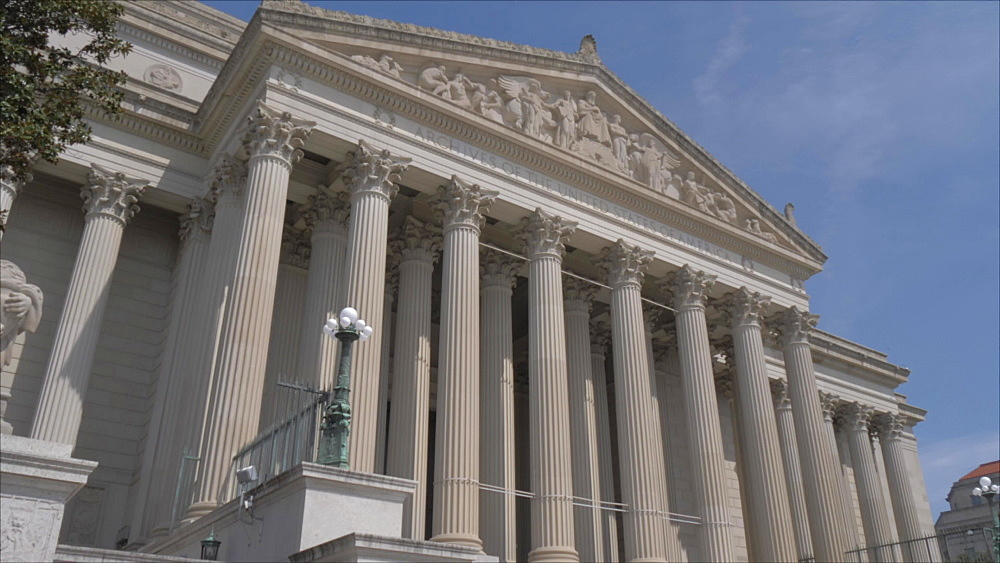 Pan shot of National Archives Research Center on Constitution Avenue, Washington DC, District of Columbia, USA