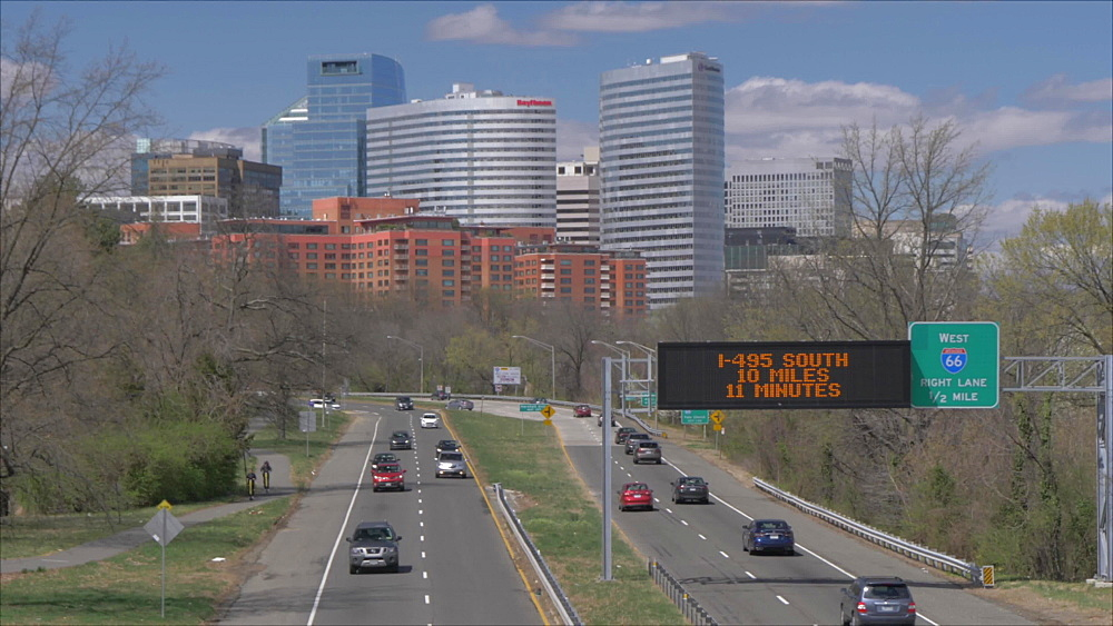 Tilt shot of highway traffic and North Rosslyn District skyline from Memorial Avenue, Washington DC, District of Columbia, USA - 844-20134