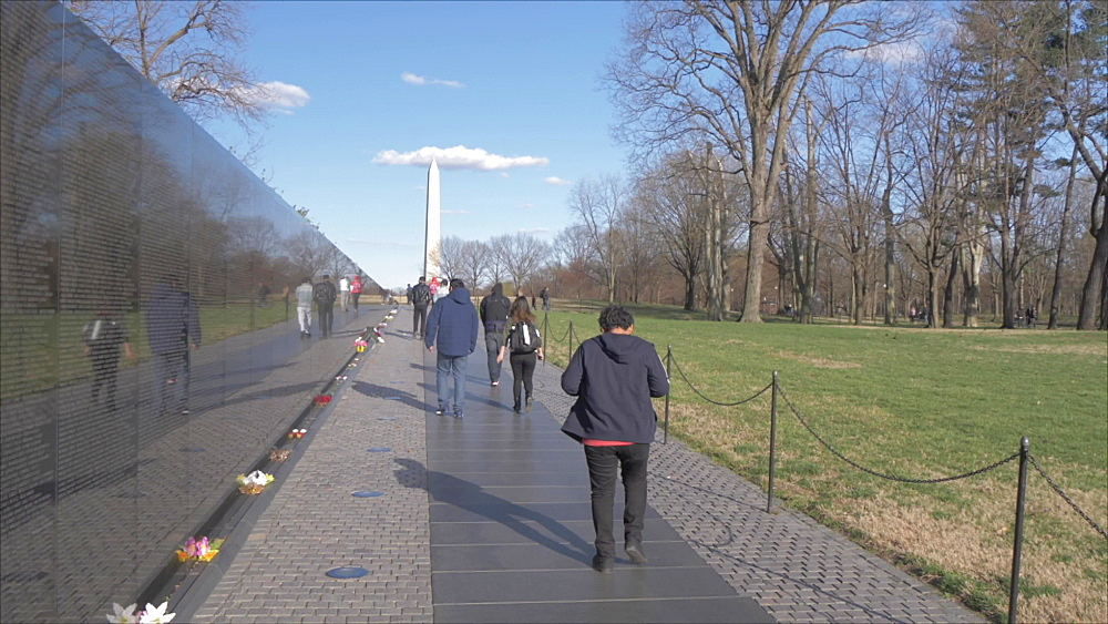 Crane shot of Vietnam Veterans Memorial, people and Washington Monument, Washington DC, District of Columbia, USA, North America