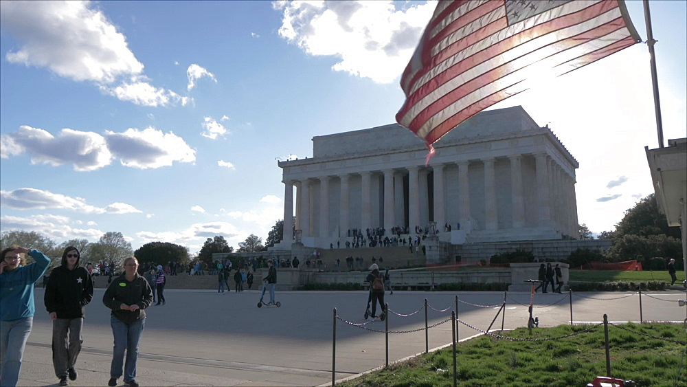 Still shot of American flag flying at Lincoln Memorial on National Mall, Washington DC, District of Columbia, USA, North America