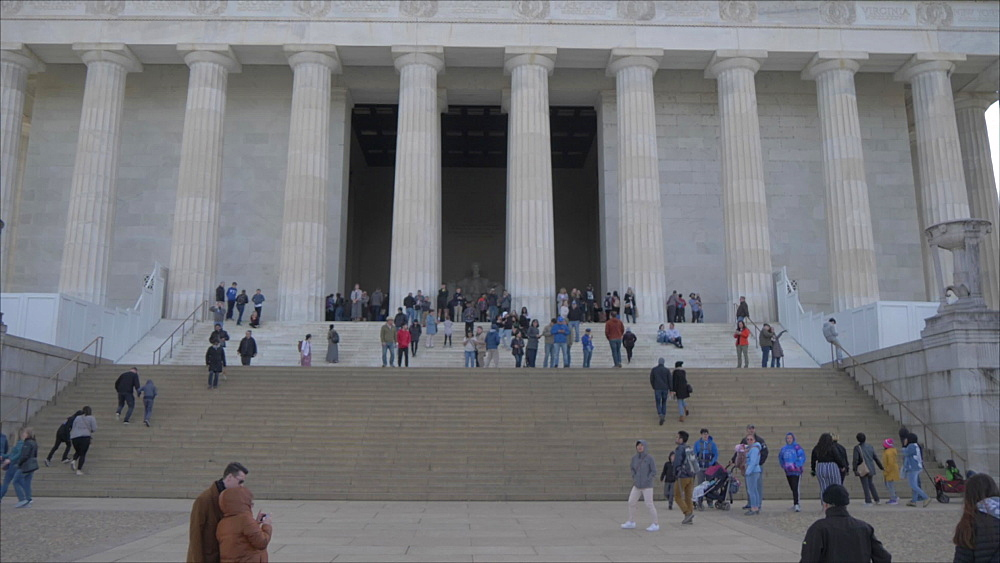 People and facade of Lincoln Memorial at sunset, Washington DC, United States of America, North America
