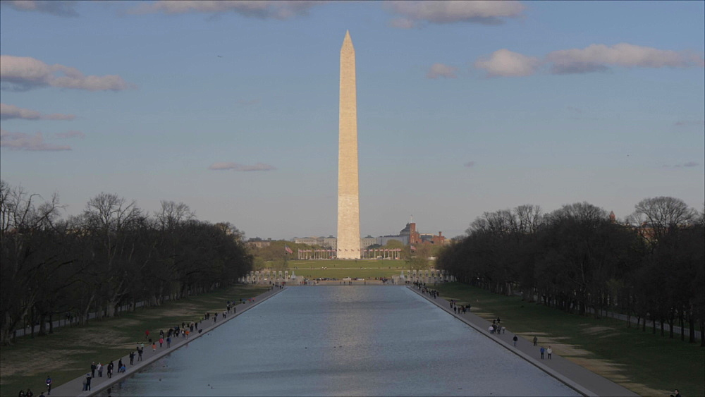 Tilt shot of Washington Monument and Reflecting Pool at sunset from Lincoln Memorial, Washington DC, District of Columbia, USA, North America