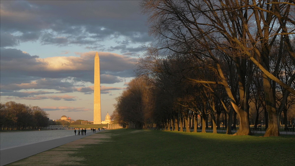 Pan shot of Washington Monument and Reflecting Pool at sunset from Lincoln Memorial, Washington DC, District of Columbia, USA, North America