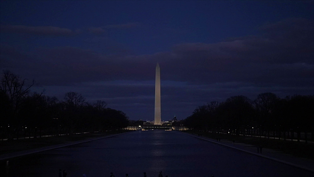 Tilt shot of Washington Monument and Reflecting Pool at night from Lincoln Memorial, Washington DC, District of Columbia, USA, North America