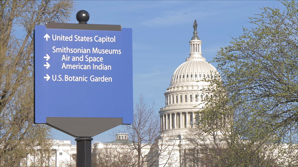 Tilt shot of sign post and United States Capitol building, Washington DC, District of Columbia, USA, North America