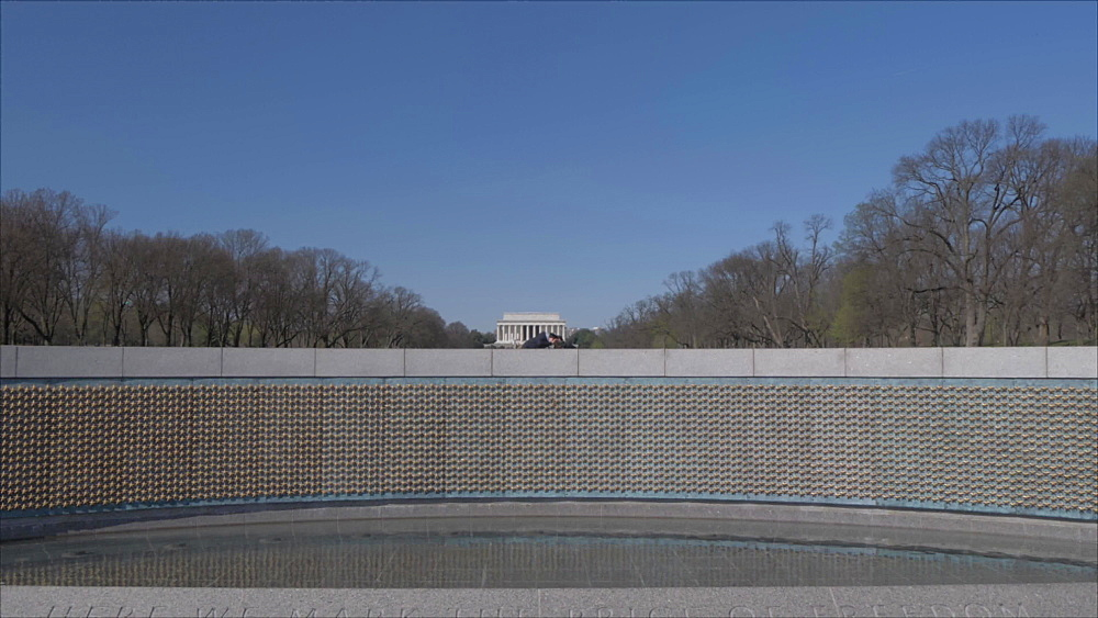 Crane shot of World War ll Memorial revealing Lincoln Memorial, Washington DC, District of Columbia, USA, North America