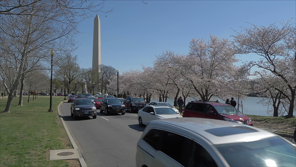 Crane shot of traffic and Washington Monument, Washington DC, District of Columbia, USA, North America