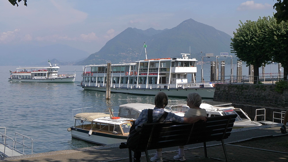 Still shot of ferryboats, lake and people on a sunny afternoon, Lake Maggiore, Stresa, Piedmont, Italian Lakes, Italy, Europe