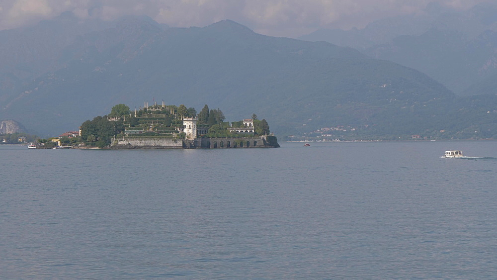 Pan shot of boat from lakeside walk and Borromean Islands, Lake Maggiore, Stresa, Piedmont, Italian Lakes, Italy, Europe