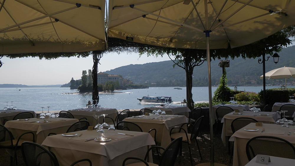 Shot through restaurant of Isola Bella from Isola dei Pescatori, Lake Maggiore, Piedmont, Italian Lakes, Italy, Europe