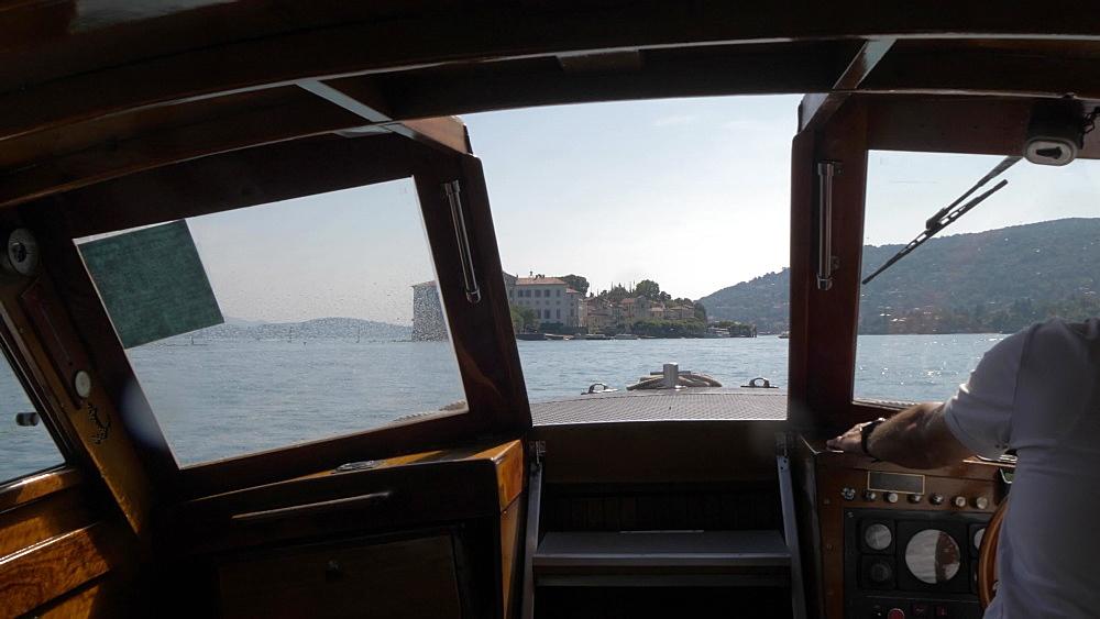 Onboard boat shot towards Isola Bella from Isola dei Pescatori, Lake Maggiore, Piedmont, Italian Lakes, Italy, Europe