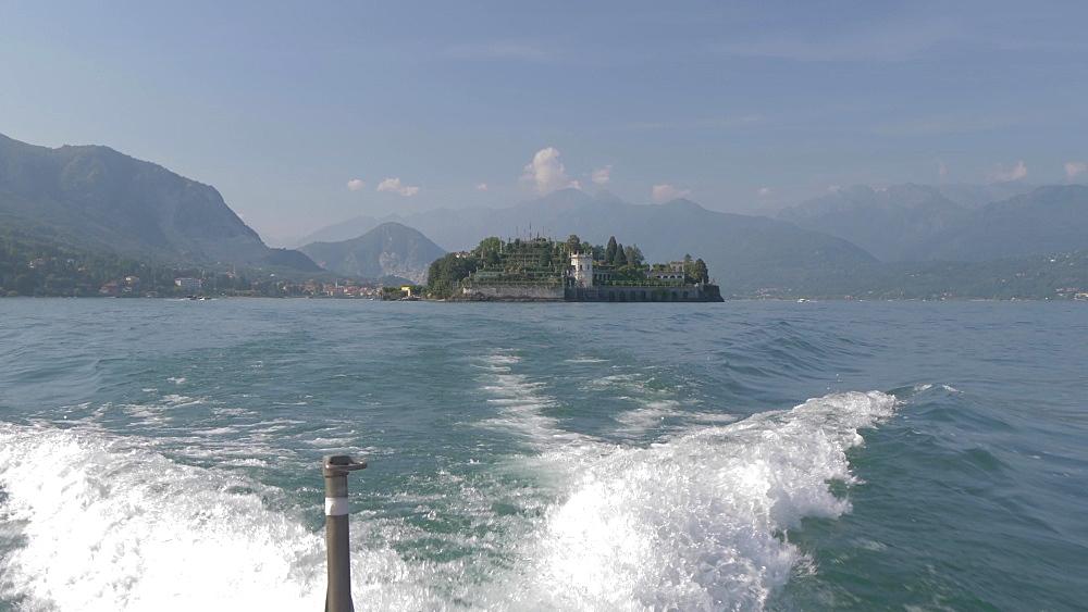 Onboard boat shot leaving Isola Bella, Borromean Islands, Lake Maggiore, Piedmont, Italian Lakes, Italy, Europe