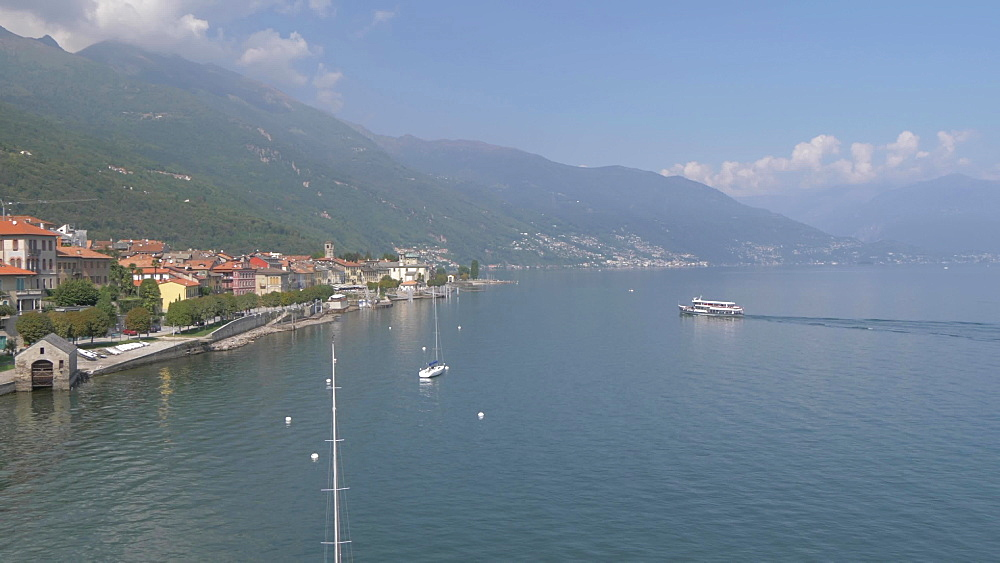 Elevated pan view of ferryboat arriving at Cannobio and Lake Maggiore, Lake Maggiore, Piedmont, Italian Lakes, Italy, Europe