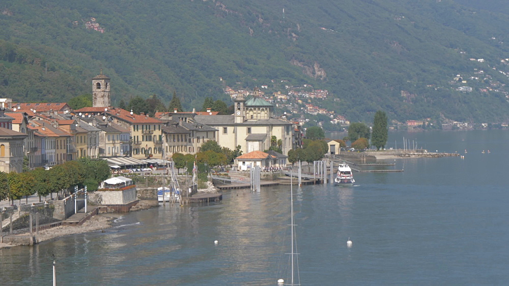 Elevated view of ferryboat arriving at Cannobio and Lake Maggiore, Lake Maggiore, Piedmont, Italian Lakes, Italy, Europe