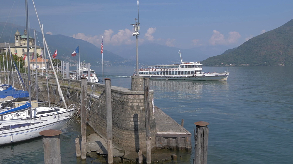 Ferryboat leaving harbour in Cannobio on Lake Maggiore, Lake Maggiore, Piedmont, Italian Lakes, Italy, Europe