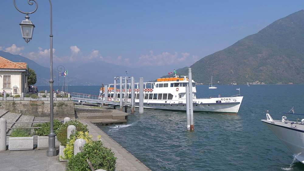 Lakeside walk and ferryboat leaving harbour in Cannobio on Lake Maggiore, Lake Maggiore, Piedmont, Italian Lakes, Italy, Europe