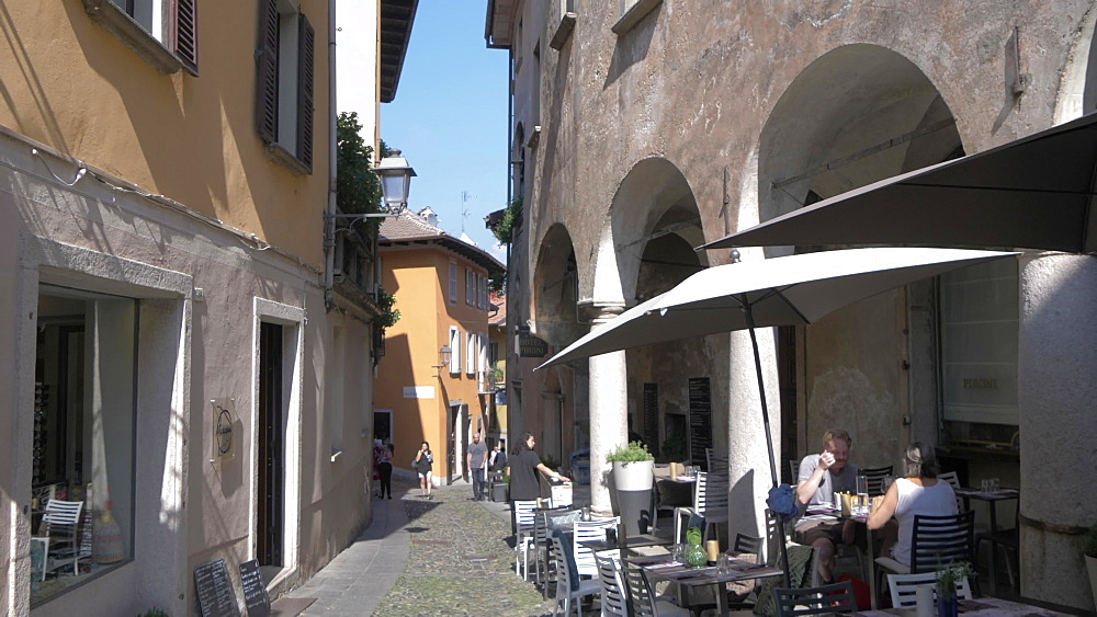 Narrow street and cafe in Cannobio on Lake Maggiore, Lake Maggiore, Piedmont, Italian Lakes, Italy, Europe