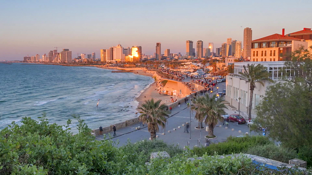 Time lapse of sun setting on Tel Aviv skyline as viewed from Jaffa Old Town, Tel Aviv, Israel, Middle East