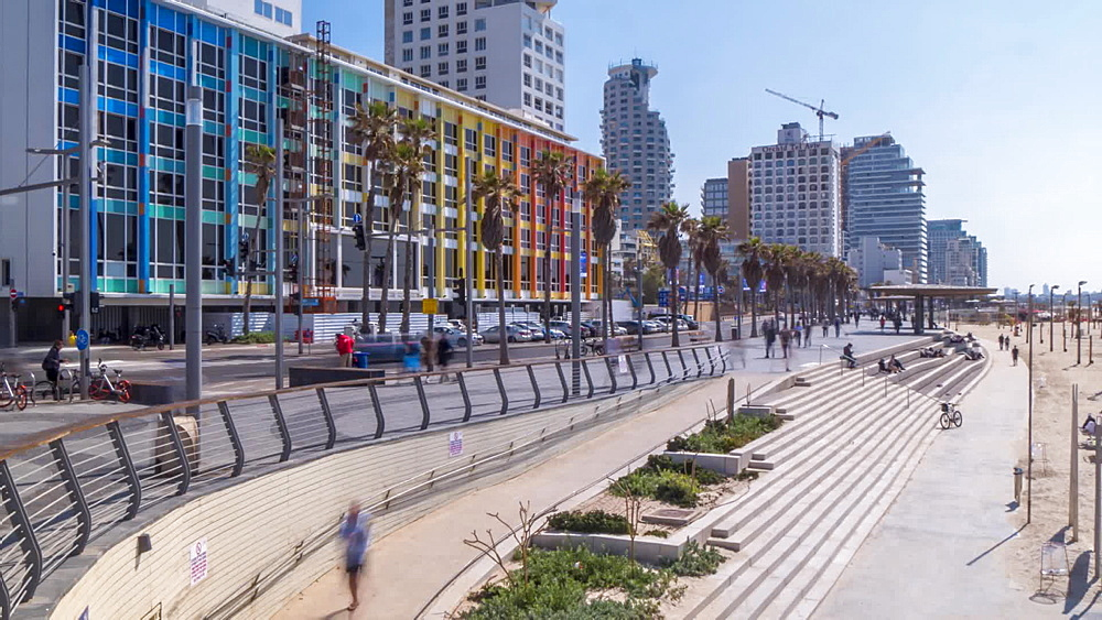 Time lapse of traffic, people and colourful buildings and promenade on Hayarkon Street, Tel Aviv, Israel, Middle East