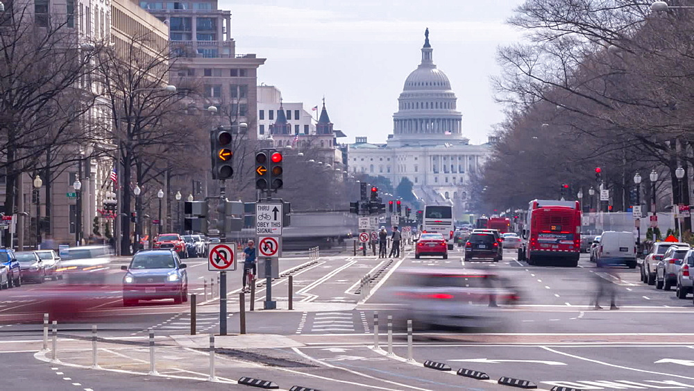 Time lapse of people and traffic on Pennsylvania Avenue and US Capitol Building, Washington DC, United States of America, North America