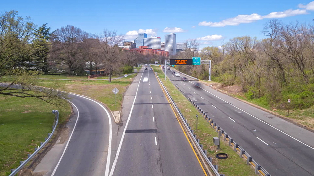 Time lapse video of North Rosslyn skyline and traffic on Richmond Highway, Washington DC, District of Columbia, United States of America