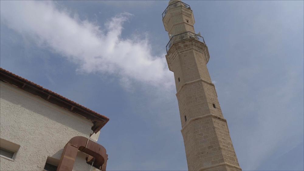 Tilt shot of Mahmudiyya Mosque minaret in Jaffa Old Town, Tel Aviv, Israel, Middle East