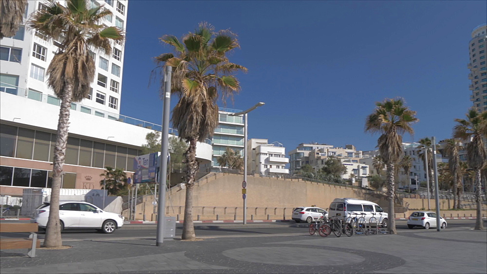 Beachfront promenade in front of the colourfully decorated hotel facades, Tel Aviv, Israel, Middle East