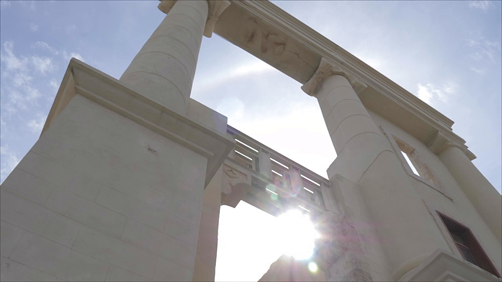 Sun shining through columns near The Clock Tower in Jaffa Old Town, Tel Aviv, Israel, Middle East
