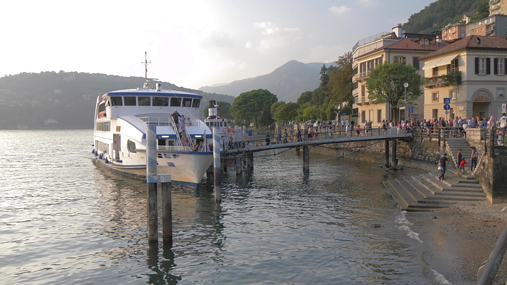 Passengers disembarking ferryboat on lakeside in Como town, Como, Lake Como, Lombardy, Italian Lakes, Italy, Europe
