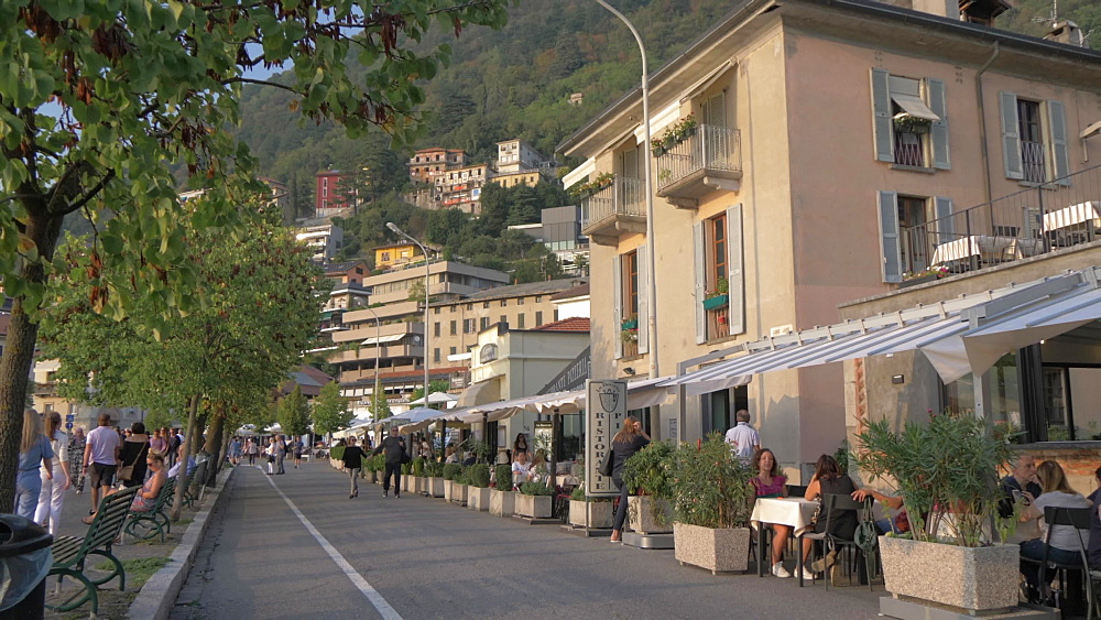 Cafes and restaurants on lakeside walk in Como town at early evening, Como, Lake Como, Lombardy, Italian Lakes, Italy, Europe