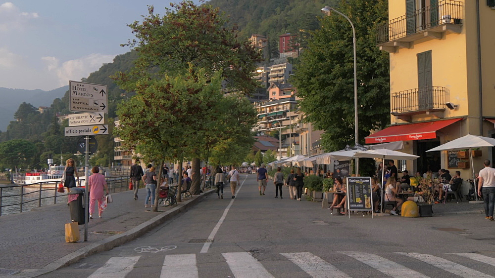 Cafes and restaurants on lakeside walk in Como town at sunset, Como, Lake Como, Lombardy, Italian Lakes, Italy, Europe