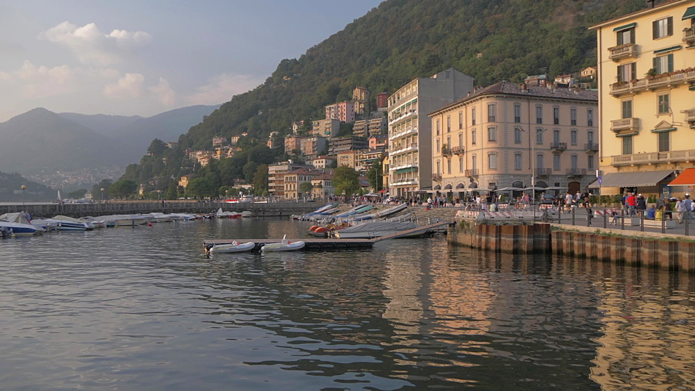 Harbour boats on lakeside in Como town at sunset, Como, Lake Como, Lombardy, Italian Lakes, Italy, Europe